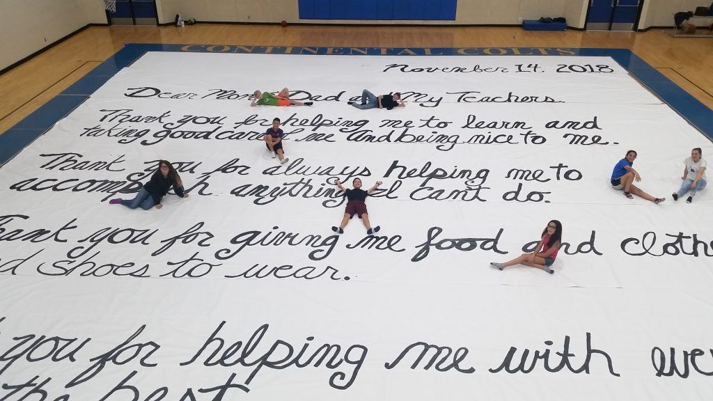 Having fun on top of World's Largest Thank You Letter.